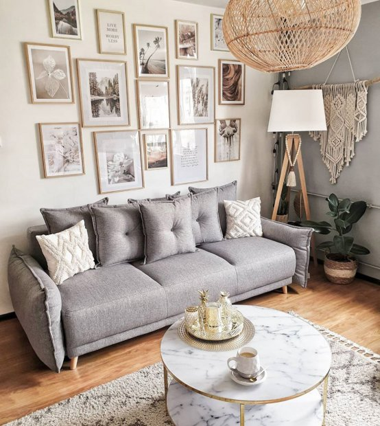 Beautiful large gallery wall beige grey living room posters